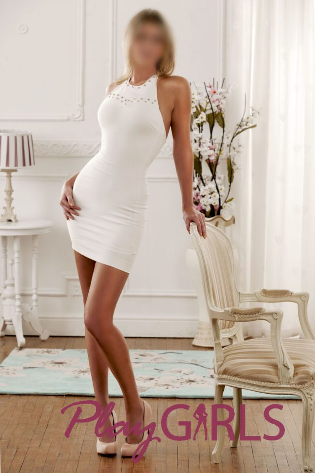 escort dressed in white with gold chair